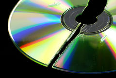 Data loss. Broken CD or DVD isolated on black ground Stock Image