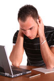 Data loss. A stressed student at his workplace. All isolated on white background Stock Photos