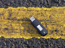 Data loss. Memory stick with the words 1GB lying on the roadside Stock Photography