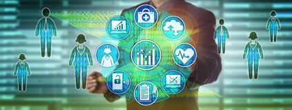 Data Manager Measuring Population Healthcare. Healthcare information officer measuring performance via dashboard. Health care information technology concept for Stock Photos