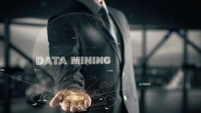 Data mining con il concetto dell'uomo d'affari dell'ologramma illustrazione di stock
