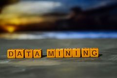 Data mining on wooden blocks. Cross processed image with bokeh background stock images