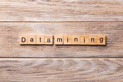 Data mining word written on wood block. Data mining text on wooden table for your desing, concept stock image