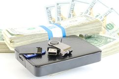 Portable drive USB on stack of dollar bundles for data is money Royalty Free Stock Photography