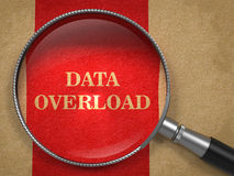 Data Overload Through Magnifying Glass. Data Overload Inscription Through Magnifying Glass on a Red Background Royalty Free Stock Photography