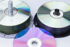 Data preservation. Image shows some stacks of CD's isolated on white background Royalty Free Stock Photography
