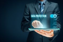 Data protection concept. Businessman click on button to activate data protection royalty free stock images