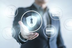 Data protection and network security concept. Business man with shild and internet icon n stock image