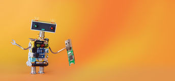 Data recovery backup service robot with usb flash storage stick. orange yellow gradient background, copy space.  Royalty Free Stock Photo