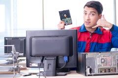The data restoration specialist repairing corrupt hard drive. Data restoration specialist repairing corrupt hard drive Stock Photos