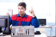 The data restoration specialist repairing corrupt hard drive. Data restoration specialist repairing corrupt hard drive Royalty Free Stock Images