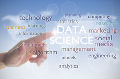 Data science word cloud. Finger pressing touch screen with data science royalty free stock photography