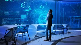 Data scientist looking at the transparent screen and thinking. Working alone. Calm thoughtful data scientist looking attentively at the transparent screen while royalty free stock photos
