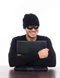 Data security. Friendly hacker stealing your data as concept of business security Royalty Free Stock Photo