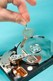 Data security. Computer hard-drive with key Stock Image