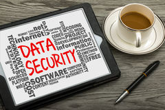 Data security handwritten on tablet pc with related word cloud stock image