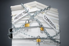 Data security. Protected documents. Confidential information. Locked pile of documents and folder. Gray background Stock Images