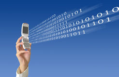 Data sending. Woman's hand holding modern mobile phone. Phone is sending data via wireless network Royalty Free Stock Image