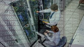 Data Server Room. IT professionals working in Data Server Room against number background stock footage