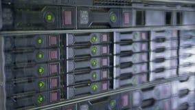 Data servers working. Flashing LED lights of network station. 4K stock footage