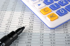 Data sheet, account pen and calculator Stock Photography