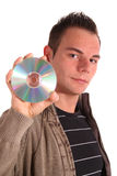 Data storage. A handsome teenager holding a cd or dvd. All isolated on white background Stock Photo