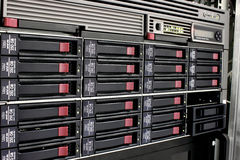 Data storage rack. Servers stack with hard drives in a datacenter for backup and data storage Stock Photos