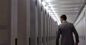 Data technician walking through locker hall stock footage