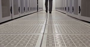 Data technician walking through locker hall stock footage