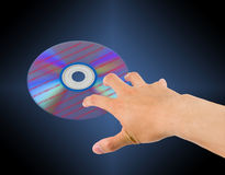 Data theft. Security concept with hand stealing data disc stock photos