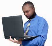 Data Thief. Man stealing data from a laptop isolated Stock Photography