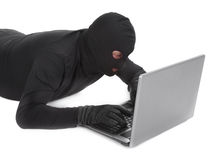 Data thief with laptop Royalty Free Stock Photography