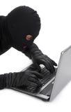 Data thief with laptop Stock Photos