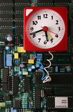 Data Time Bomb. Clock 'wired' to a circuit board royalty free stock photos