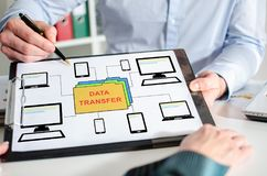 Data transfer concept on a clipboard. Businessman showing data transfer concept on a clipboard Stock Photography