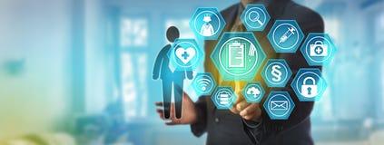 Dataadministratör Accessing Health Record Royaltyfria Bilder