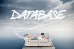 Database against cloudy sky over ocean Royalty Free Stock Photography