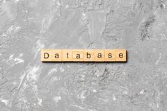 Database word written on wood block. database text on table, concept