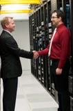 Datacenter deal. Business men shaking hands after making a deal stock photos