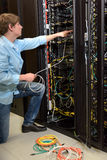 Datacenter manager working on server Stock Photography