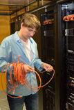 Datacenter professional checking network cables Stock Images