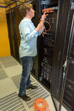 Datacenter professional in server room Stock Photography