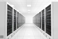 Datacenter with two rows. Of computers in white room Royalty Free Stock Photo