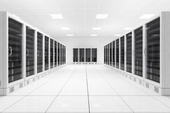 Datacenter with two rows. Of computers in white room Royalty Free Stock Photos