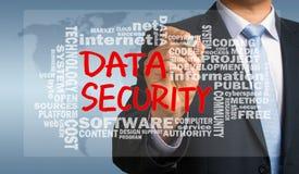 Datasäkerhet som är handskriven vid affärsmannen med det släkta ordmolnet Arkivbilder
