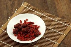 Datas wolfberry e vermelhas chinesas Fotos de Stock