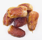 Date. Some appetizing dried dates are isolated on a white background stock photos