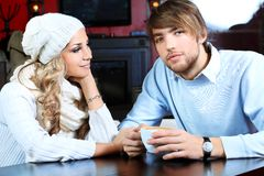 Date. Happy couple of young people having a date at a caf Stock Images