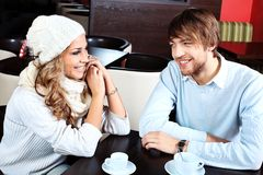 Date. Happy couple of young people having a date at a caf Royalty Free Stock Image