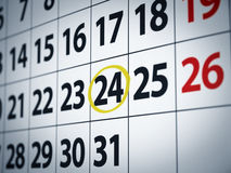 Date on the 24th. A date circled on a calendar with yellow ink Stock Photo